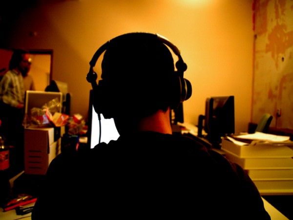 man listening to music at computer